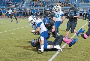 Letcher Central's Isaiah Cornett pulled North Laurel's quarterback to the ground, while teammate Hunter Campbell came in to help with the takedown in Friday's 18-6 loss for the Cougars. (Photo by Chris Anderson)