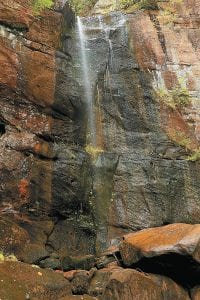 Dry autumn weather has reduced the water feeding Bad Branch Falls to nearly a trickle. The falls are located at the headwaters of the Cumberland River near Oven Fork in Letcher County. (Photo by Thomas Biggs)