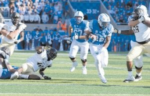 In photo at left, Benny Snell (25) impressed UK offensive coordinator Eddie Gran with his physical play on the basketball court in high school and says Snell reminds him of former Bengals running back Rudi Johnson. (Photo by Vicky Graff )