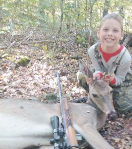 Dylan Ford Watts was all smiles after his success on opening day of Kentucky's youth-only hunt.