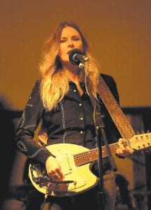 """Country music artist Elizabeth Cook performed before a nice-sized crowd at Summit City in Whitesburg Saturday night. The appearance of Cook, a Grand Ole Opry performer, continues Summit City's long run of bringing acclaimed musicians to Letcher County. The concert featured songs both upbeat and those more somber such as """"Heroin Addict Sister,"""" an ode to a family member who suffers from addiction. (Photo by Thomaas Biggs)"""