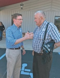 — Lexington Mayor Jim Gray spoke with Leonard Fleming of Kona during a Democrat Party rally at the Shriners' building in Whitesburg October 29. Gray is trying to unseat Republican Rand Paul in the U.S Senate.