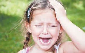 Up to 10 percent of U.S. school-aged kids have migraine headaches. A new study says treatment options for the debilitating headaches are few, as sugar pills worked as well as preventing kids' migraines as two commonly used medicines. Side effects from the drugs were common, including fatigue, dry mouth and forgetfulness. (Shutterstock)