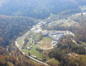 This photo taken from a small airplane shows fall foilage surrounding the neighborhoods and campus that make up the area around Letcher Middle and Elementary School. Surrounding the school buildings and houses are KY Highway 7, Rockhouse Creek, and the CSX Railroad track. (Mountain Eagle photo courtesy attorney Doug Holliday of Hazard and the Friendship Flying Service, also of Hazard and piloted by Jeff Hylton)