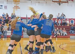 LCC volleyball team claims 14th Region title ENTHUSIASM GAP — Members of the Letcher County Central High School volleyball team mobbed teammate and tournament MVP Alli Shepherd as disappointed Knott County Central fans looked on after the Lady Cougars defeated the Lady Patriots three sets to none in the finals of the 14th Region Volleyball Tournament at Leslie County High School in Hyden. Letcher Central won 25-20, 25-15, and 25-17 as they completed district and regional play without losing a single set. The Lady Cougars will face West Jessamine in the opening round of the KHSAA Girls' Volleyball Tournament at 3 p.m. Thursday at Valley High School in Louisville. (Photo by Chris Anderson)