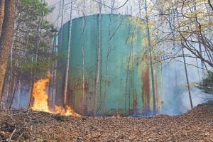 A brush fire on Pine Mountain at Jenkins surrounded a water tank at the head of No. 3 Hollow Monday afternoon. The fire has burned about 2,000 acres. (Photo by Chris Anderson)