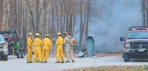 Volunteer firefighters from across Kentucky take a much-needed break while battling brush fires at the Little Shepherd Amphitheater at Jenkins. (Photo by Chris Anderson)