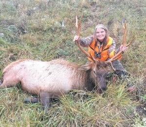 Elizabeth Wright Jones of Whitesburg is photographed with an elk bull she killed recently after being selected to hunt in Kentucky's elk lottery program. She is the mother of four children — Tyler, Kealan, Jackson and Kaleigh. She lives in Whitesburg with her husband Kenneth. The bull was one of 11 males and three females taken so far duing the elk hunting seasons on Letcher County. Seven elks have been taken by firearms in Letcher. The other seven were archery kills.