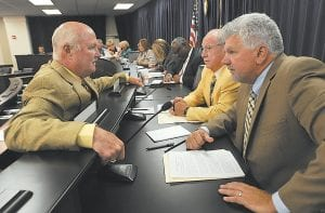 Sen. Johnny Ray Turner, D-Prestonsburg, (left) confers with Rep. Hubie Collins, D-Wittensville, and Rep. Cluster Howard, D-Jackson, prior to the November 14 meeting of the Interim Joint Committee on Education. Turner, whose district includes all of Letcher County, ran unopposed in last week's election.