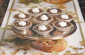 This photo shows mini chocolate pecan pies at the Institute of Culinary Education in New York. This dish is from a recipe by Elizabeth Karmel. (AP Photo)