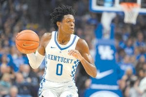 DeAaron Fox admits his hair draws a lot of attention, but freshman teammate Bam Adebayo thinks Fox just doesn't want to spend his own money to get a haircut. (Photo by Vicky Graff )