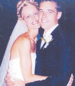 Nick and Julie Caine are pictured on their wedding day in 2004. She died on November 5, a victim of cancer.