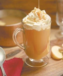 This photo shows a hot cider cocktail. This drink is from a recipe by the CIA. (Phil Mansfield/The Culinary Institute of America via AP)