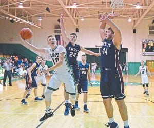 Jenkins senior Dallas Simon heaved the ball toward the hoop in Monday's season-opening matchup against 14th Region power Knott Central. The Cavs fell, 85-37. (Photo by Chris Anderson)