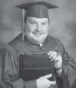 "Larry Kevin Day holds the diploma he received at his high school graduation He is a radio announcer and Whitesburg correspondent Oma Hatton says, He is ""doing a good job."""
