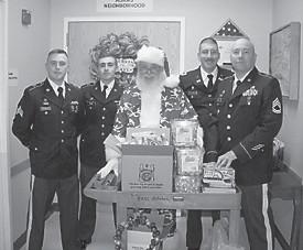 """Members of the Hazard National Guard unit visited the East Kentucky Veterans' Center to deliver items donated by local merchants and Guard members. They also wanted to thank the veterans for their service to this country. The veterans, in turn, thanked the Guardsmen for all that they do, including their upcoming deployment to the Middle East. Pictured are (left to right) Sgt. Matthew Joseph, formerly of Hyden, PV2 Jared Couch of Hyden, Captain Kringle of """"Up North,"""" Lt. Matt Fegenbush of Louisville, and SFC Matt Caudill, formerly of Carcassonne."""