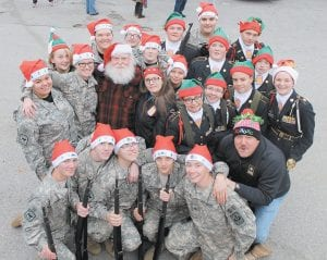 Members of the Letcher County Central High School JROTC performed Saturday in the Jenkins Christmas Parade. Performing were the Color Guard, Drill Teams, and Cadets who carried the parade banner and passed out candy. The Color Guard consists of Cadets James Stidham on the U.S. Flag, Zack Kiser on the State Flag, Susie Caudill on the School Flag, Madison Adams on the Army Flag, Taylor Hall and Steven Collins on the Rifles, and Luke Little and Hannah Caudill on the Sabers. The Unarmed Exhibition Drill Team consists of Cadets Jessika Moushon, Makayla House, Gracie Hall, Ashley Haley, and Elizabeth Haley. The Armed Duel Exhibition Drill Team consists of Cadets Jason Adams and Caleb Johnson. The Armed Exhibition Drill Team consists of Cadets Kody King, Dalton Werely, and Ezekiel Hampton. The banner carrier's were Cadets Amy Stamper and Chase McBee. The Cadets that passed out candy were Cadets Emily Collier, Amara Martin, and Courtney Browning. Above, the parade participants and instructor, Sgt. Michael Sexton, posed with Santa Claus. (Cutline information provided by 2nd Lieutenant Jessika Moushon. Photo by Damaris Sexton)