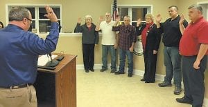 Letcher Circuit Judge Jimmy Craft (left) administered the oath of office to Toni Jenkins, Garnett Bentley, Rebecca Amburgey, Mike Dingus, and Chuck Anderson.