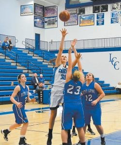 Letcher Central's Emma Maggard put up a shot during the Lady Cougars' 62-48 win over Betsy Layne on Monday. Maggard scored 13 points in the game, which saw the Lady Cougars' record improve to 3-0 on the season. (Photo by Chris Anderson)