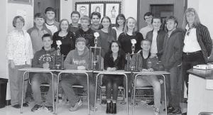 — The Letcher County Central High School academic team took first place in both its league and tournament play with the Kentucky Valley Academic League. Team members are (seated, left to right) Gavin Sexton, Corey Sparkman, Kirsten Sexton, McKenzie Miller, (standing, front row) Coach Pam Holbrook, Caleb Lewis, Courtney Whitaker, Hayden Caudill, Elle Eldridge, Annie Conder, Katie Braswell, Bryan Epperson, Coach Regina Donour, (standing, back row) Logan Martin, Sheldon Tolliver, Drew Richardson, Kiley Short and Josh Caudill. Not pictured are Treston Hughes and Nikole Lee.