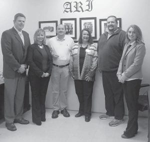 Pictured (left to right) are Jenkins Middle School Principal Eddie Whitaker, District Instructional Supervisor Serena Anderson, teacher Brian Bentley, Abbie Combs of the Kentucky Valley Educational Cooperative, Jenkins Schools Superintendent Mike Genton, and District Innovative Coordinator Christle Carter.