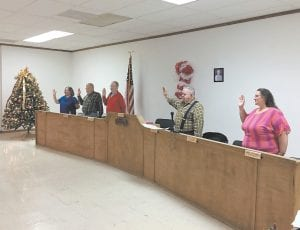 From left, Susie Fleming, James D. Collins, Jeff Breeding, Tom Haynes and Linda Cantrell are sworn in for a two-year term on the Fleming-Neon City Council by Letcher Circuit Judge Jimmy Craft, who is out of camera range. (Photo by William Farley)
