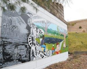 The mural, located near Jenkins High School, measures 10 feet high x 45 feet wide. (Photo by Haley Hatfield)