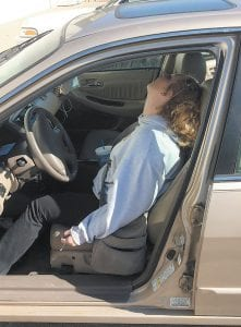 The country's out-of-control problem with addiction to heroin and prescription drugs has resulted in scenes like this one becoming all too common for police and emergency medical personnel. In this recent photo provided by the Town of Hope Police Department in Indiana, Erika Hurt sits in front with her baby in the back seat of a car in Hope. Police said she appeared unresponsive from an overdose and had a syringe in her hand. While Ms. Hurt was able to be saved from death, when more than 50,000 Americans died of overdose deaths in 2015, according to new government statistics. (Town of Hope Police Department via AP)