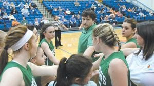 — Jenkins Coach Wesley Bryant gathered his team after a timeout in the Lady Cavs' road matchup against Pike Central last week. Jenkins (1-5) fell, 80-35. The Lady Cavs will play in the Pike Invitational Saturday. (Photo by Chris Anderson)