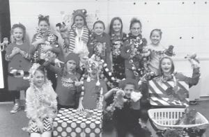 The Daisy Girls enjoyed a Christmas photo shoot and a moving party for Emma Pavalick and Molly Adams, who will be missed. Pictured are (front row, left to right) Brooklyn Howard, Macy Warf, Kirsten Caudill, Paige Caudill, Ava Thomas, (back row) McKynlee Thomas, Emma Pavalick, Madison Hall, Mia Bates, Josie Maggard, Anna Little and Anna Hatton. Not pictured is Chloe Hall.