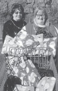 Shirley Sexton (left) and Grayson Holbrook deliver pajamas at Family Services at Ermine for the foster care children in Letcher County.