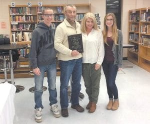 — Outgoing Jenkins Board of Education Chairman Tracy Goff, second from left, posed with son Tanner, wife Angie, and daughter Ali on Monday night. Goff received a plaque in commemoration of 16 years of service to the board at its December meeting. Goff chose not to seek re-election to another term of service.