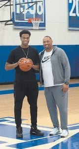 Kentucky signee P.J. Washington, shown here with his father, will be playing at Marshall County Feb. 17 and 18.