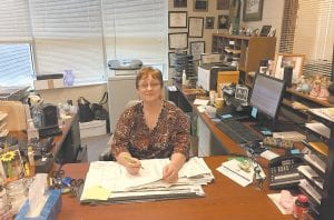 CALLING IT A DAY — Margaret Nichols, who retired from her job as Letcher Circuit Court Clerk effective December 31, was back at her desk Tuesday tying up loose ends. Nichols first won election to the office 28 years ago. Wendy Flannery of Harlan will serve as temporary clerk until a full-time replacement is appointed.