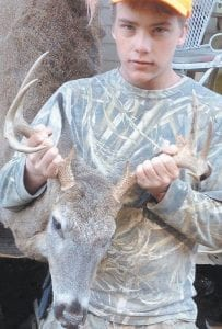 Anthony Jent, a student at Letcher County Central High School, is pictured with a nice 9-point buck he took in November.