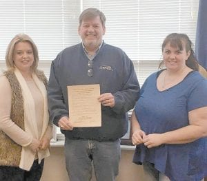 Letcher County Judge/Executive Jim Ward is pictured with Brandy Slone (right), health educator at the Letcher County Health Department, and Katrina Jones (left), county coordinator for the health department. Judge Ward has issued a proclamation explaining radon gas, and the health department is supplying free kits to test homes for radon.