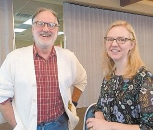 Rotarian Roy Crawford discusses literacy with Sky Marietta of Pine Mountain Settlement School at a recent Rotary Club meeting.