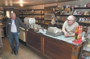 Brothers John W. Ison (right) and Joe Ison were photographed recently in John W. Ison's Grocery on Linefork. The store, one of the only ones still in that area and one of the few country stores that were left in Letcher County, is closing more than 70 years after it was opened by the brothers' parents Quentin and Emma Ison.