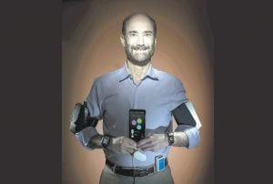 Michael Snyder, professor and chair of genetics at the Stanford University School of Medicine, sports wearable gadgets. Wearable gadgets gave a Snyder an early warning that he was getting sick before he ever felt any symptoms of Lyme disease. (Steve Fisch via AP)