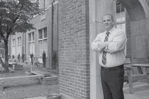 Travis Warf, President of the Appalachian Hospitality Group (AHG), stands in front of the Benham Schoolhouse Inn. AHG took over management of the Inn in July 2016.