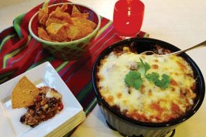 Baked Black Bean Dip will be a hit at your football party.