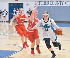 Letcher Central's Shelby Hall dribbled around traffic on the way to the basket in Monday's loss to Perry Central. LCC led by 13 points with just under five minutes to go in the game, but Perry Central rallied, going on an 18-3 run, and handing the Lady Cougars the 59-51 loss. (Photo by Chris Anderson)
