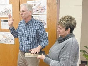 New Letcher Circuit Clerk Larry D. Adams took the oath of office while his wife, Hettie, held the Bible.