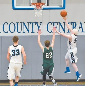 At right, Letcher Central's Michael Armstrong blew the roof off the Letcher Central gymnasium when he sank this layup late in the game. Armstrong came away with four points in the game.