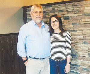 Charles Colwell, left, and his daughter, Amanda Maggard, stood near the front of Prime 606 Steakhouse Tuesday.