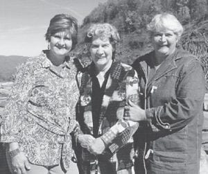 CONCERT VISIT — This photograph was taken during a visit to North Carolina to see the Primitive Quartet in concert at Harmony Valley. Pictured are Dorothy Tacket and her daughter, Charlene Mason, and Jeanette Yonts.