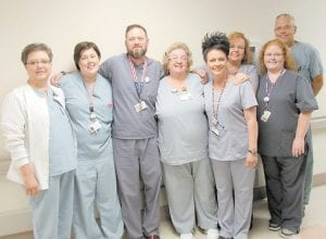 Allen Fugate was congratulated by the Whitesburg Appalachian Healthcare radiology staff after being announced as the winner of the hospital's 2016 CARES award. Pictured from left are Kim Craft, Tracy Lucas, Fugate, Alice Lucas, Margaret Calhoun, Tina Weiner, Joe Combs and Stephanie Robinson.