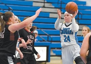 LCC GIRLS DROP TWO — Letcher Central's Shelby Hall drove to the basket in the Lady Cougars' 67-56 loss to Harlan County on Monday night. Hall led all scorers with 25 points. Entering Tuesday night's game at Cordia, LCC had a won-loss record of 15-11, including a 60-40 loss to 53rd District and 14th Region power Knott County Central on February 4. The Lady Cougars are scheduled to host Shelby Valley on Saturday for a 3:30 p.m. tipoff. (Photo by Chris Anderson)