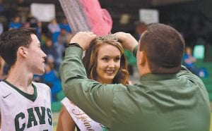 Jenkins Principal Thomas Pinion crowns Haley Mullins as the new basketball Homecoming Queen Saturday evening. Mullins was escorted by Hunter Adams, left. (Photo by Chris Anderson)
