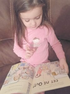 YOUNG READER — Maci Richardson, daughter of Mark and Amber Richardson, enjoys reading her favorite book, My No, No, No Day! This is one of the many books Maci received through the Imagination Library program.